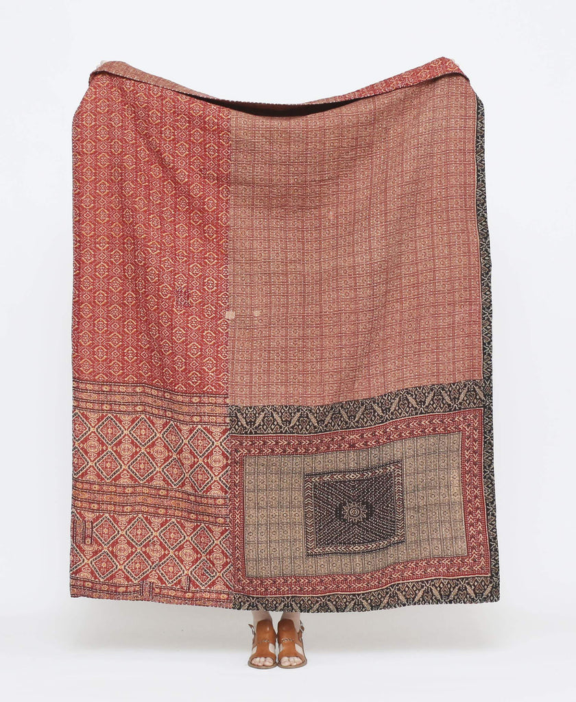 Red and brown vintage throw quilt with black detailing and geometric prints with white kantha stitching
