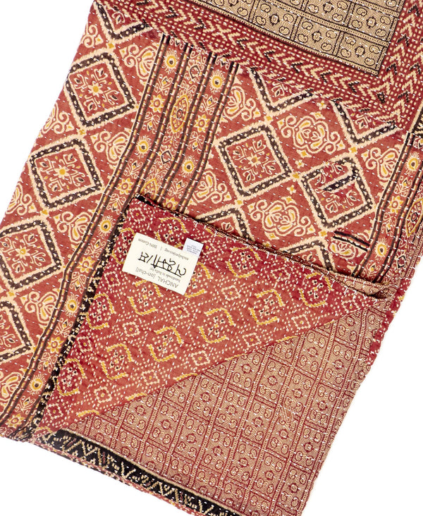Fair trade red and brown throw quilt handstitched by Anchal artisans in Ajmer India with geometric designs