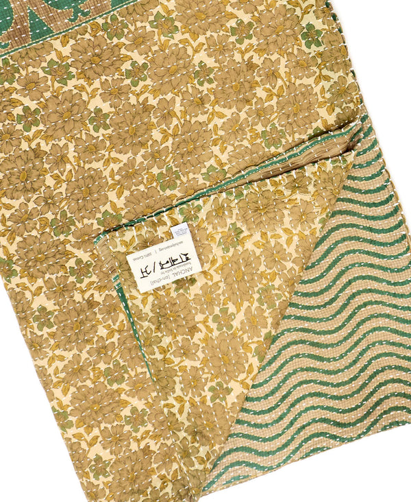 Fair trade green and brown throw quilt handstitched by Anchal artisans in Ajmer India with floral and paisley designs