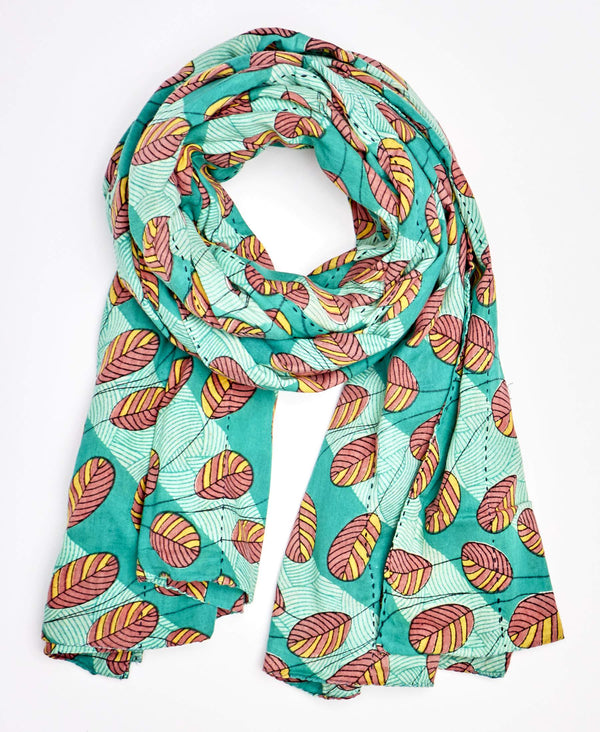 turquoise scarf with pink and orange leaf detailing made sustainably