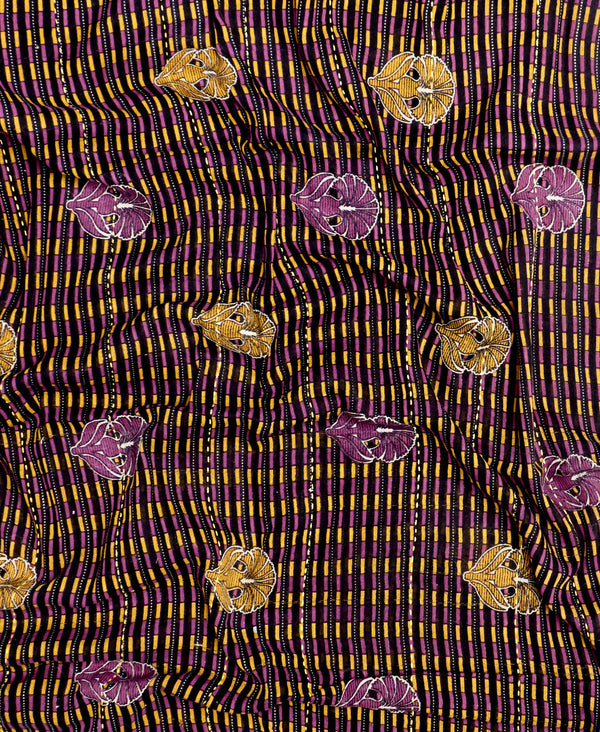Brown and purple fabric with kantha embroidery