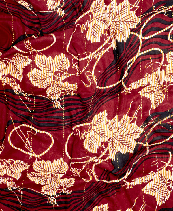 leaf pattern on maroon soft cotton fabric with white embroidery