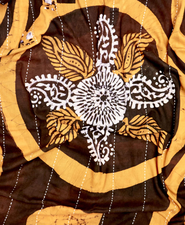 brown and yellow pattern that has been upcycled from a vintage sari