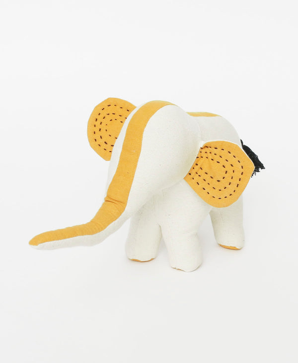 Small bone colored elephant with mustard details and black Kantha stitching