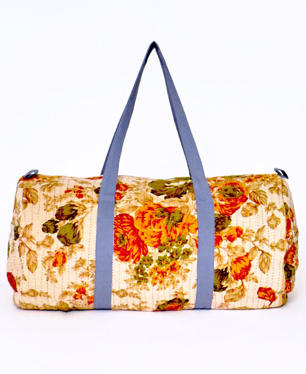 orange floral canvas duffle bag by Anchal Project
