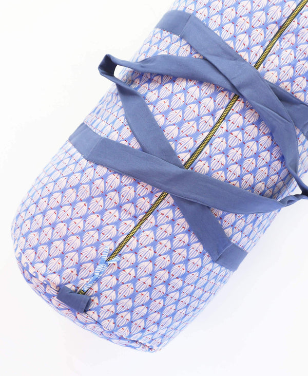 one-of-a-kind canvas duffle bag in light blue floral