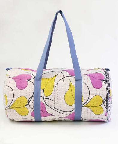 pink and yellow canvas travel bag with bold print