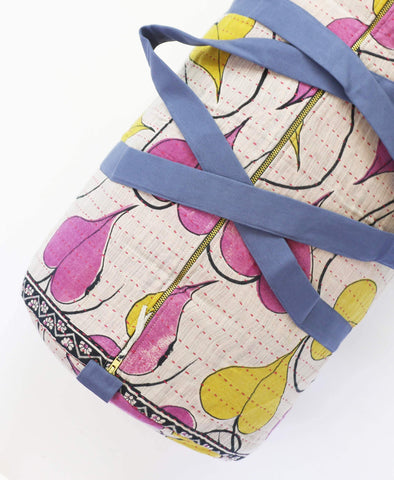 sustainably made canvas duffle bag with pink and yellow heart pattern