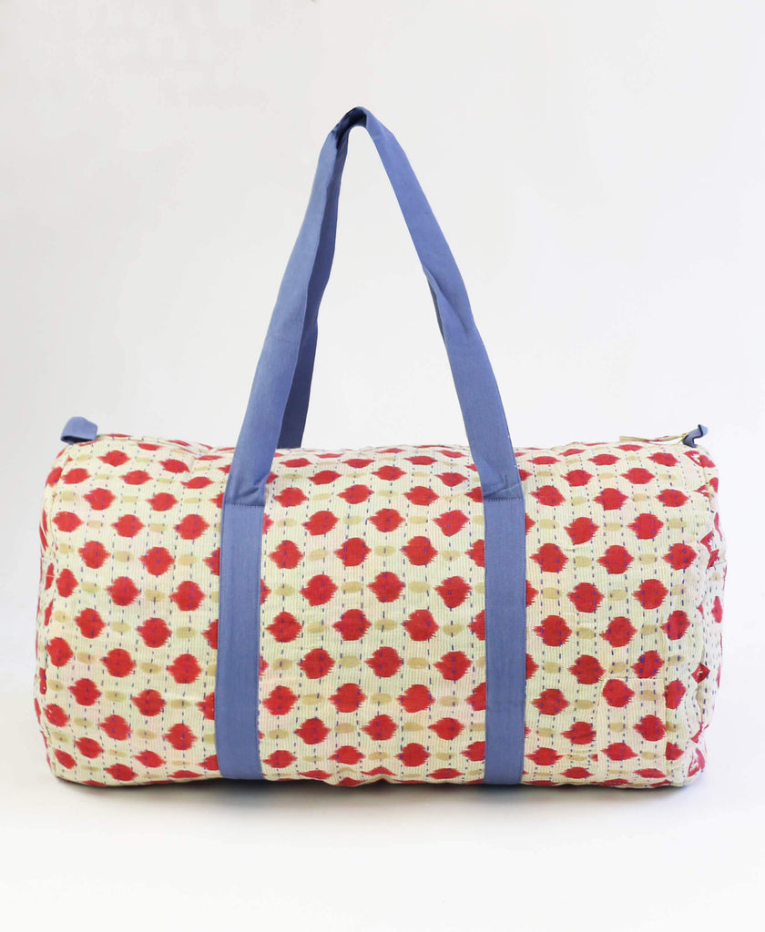 red and tan polka dot carry-on canvas duffle bag