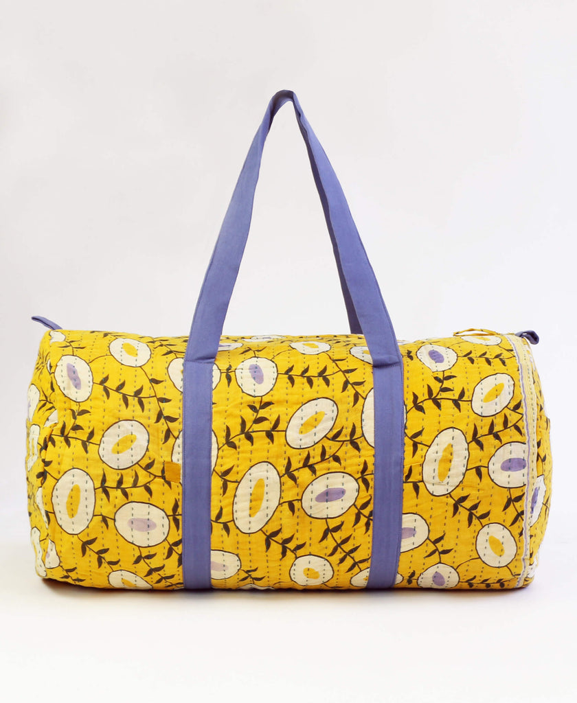 mustard canvas duffle bag made with repurposed eco-friendly fabrics