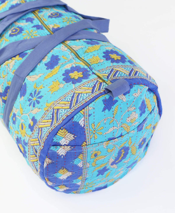 light blue gym bag made with sustainable fabrics in blue floral print