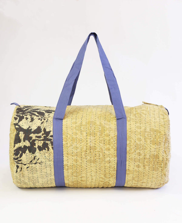 beige floral canvas duffle bag made from repurposed vintage fabrics