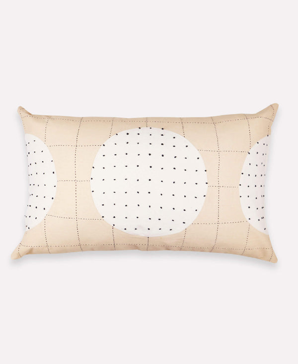 Handmade lumbar pillow with neutral, two-tone concentric pattern