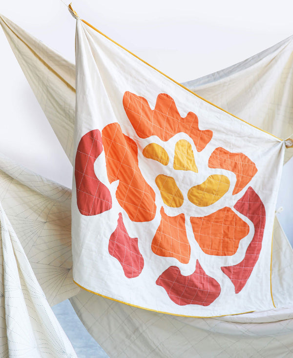 abstract floral quilt made by Anchal artisans from GOTS certified organic cotton