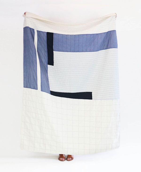 organic cotton quilted throw blanket made by Anchal artisans featuring patchwork designs