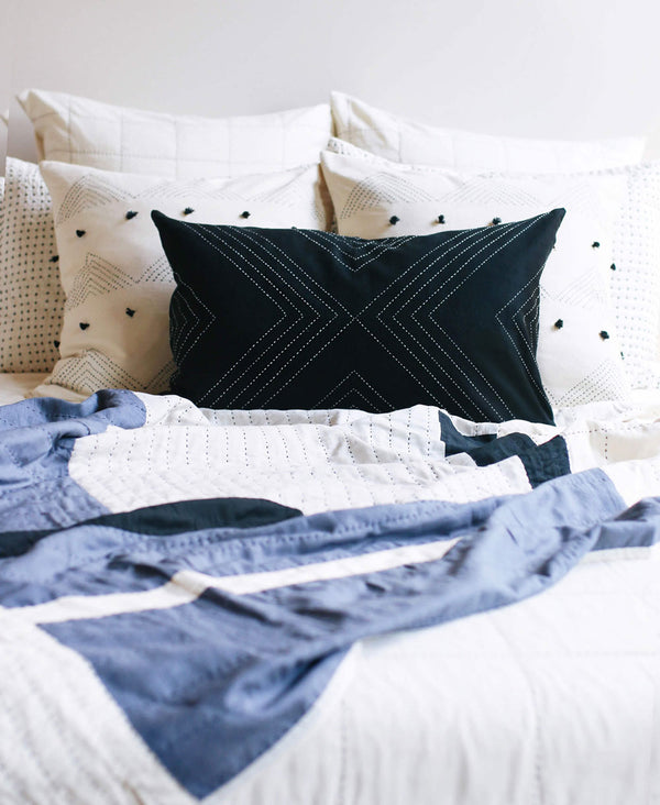 Eco-friendly Anchal patchwork quilt pairs perfectly with throw pillows and handmade bedding