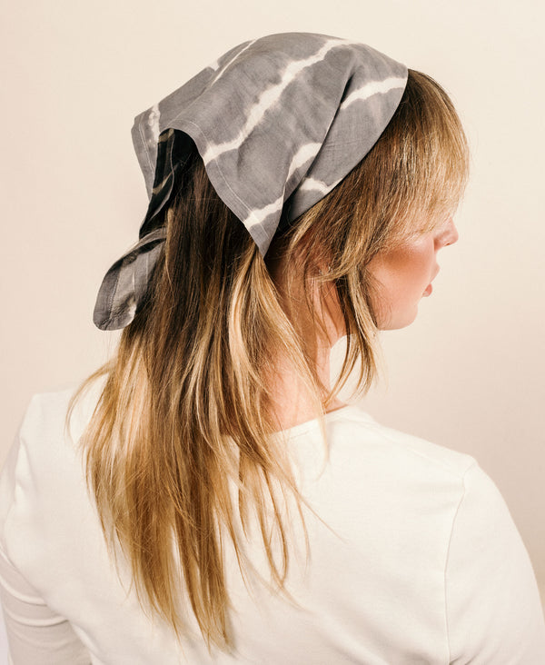 naturally dyed bandana styled in hair with tie dye effect
