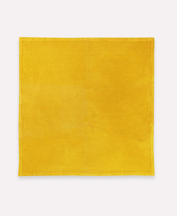 naturally dyed cotton napkin made with dried marigold flowers