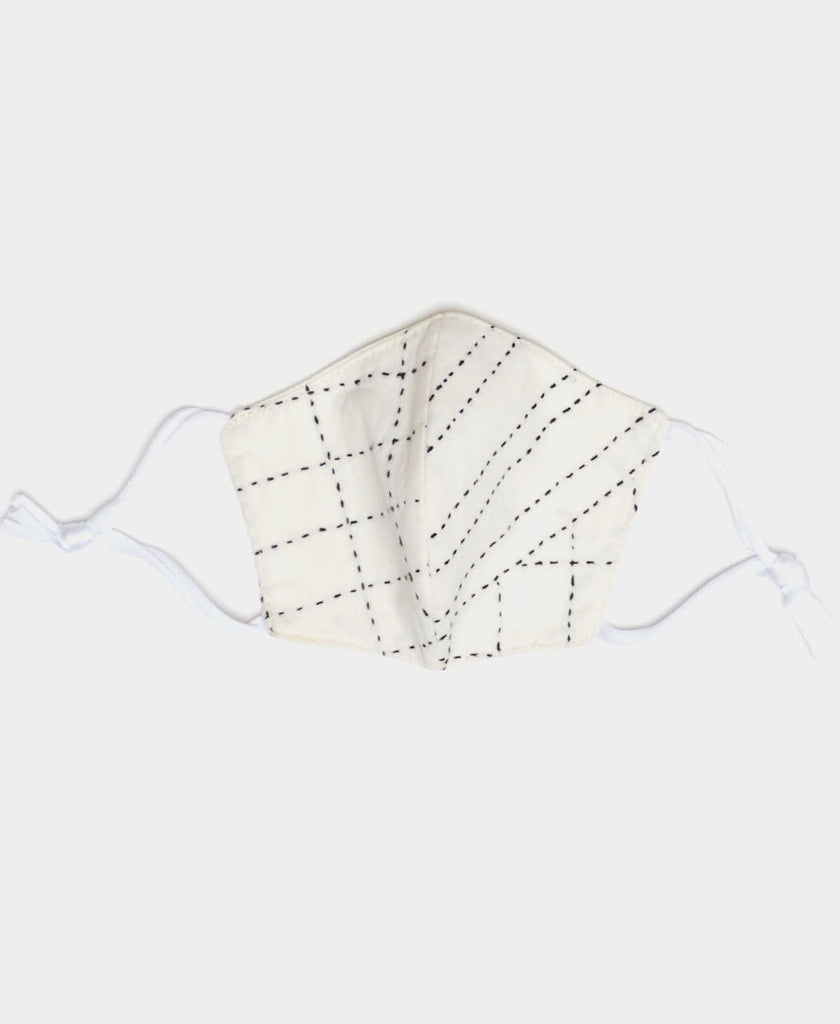 White face mask with two layers of cotton handstitched by Anchal artisans in Ajmer India