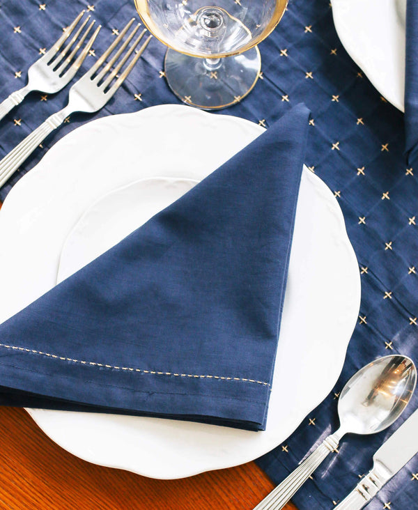 navy organic cotton napkin with gold stitching made by Anchal artisans