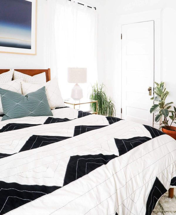 comfortable bedroom styled with organic cotton bedding and pillows handmade in India