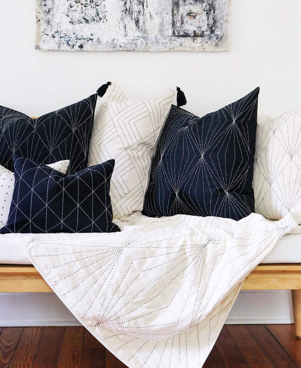 black and white modern pillows and throw on contemporary entryway bench