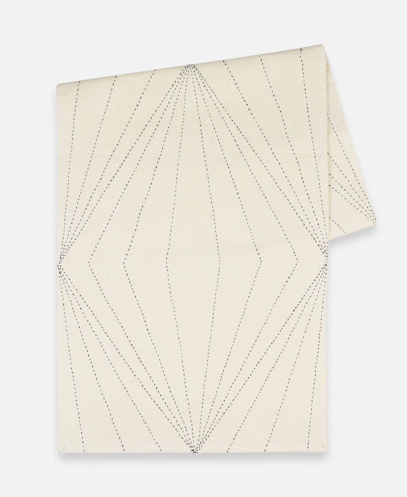 Anchal Project organic cotton table runner with hand-stitched prism design in ivory