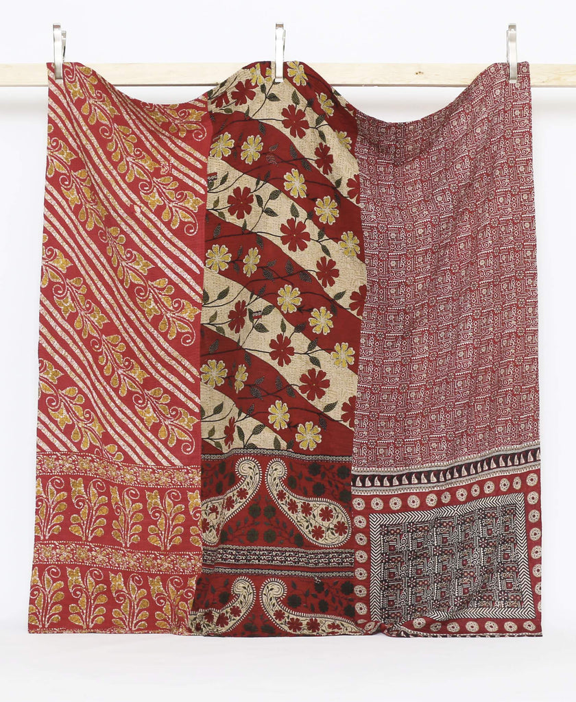 kantha quilt bedding with traditional embroidery techniques in shades of maroon