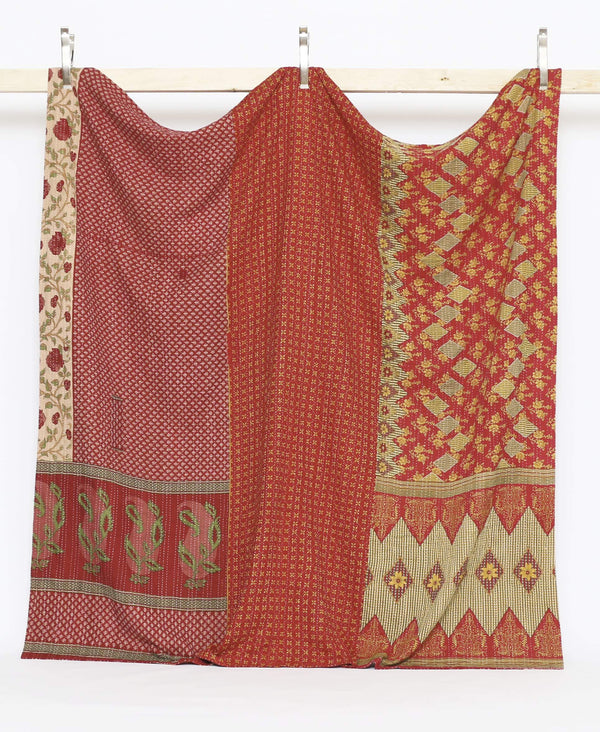 traditional embroidery used with vintage patterns to create a buttery soft quilt throw in red