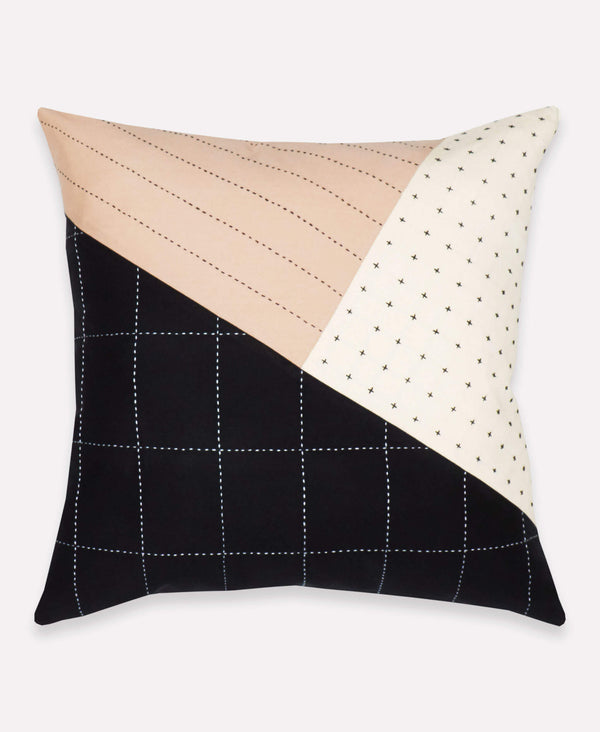 contemporary embroidered pillow with contrasting grid and cross-stitch designs