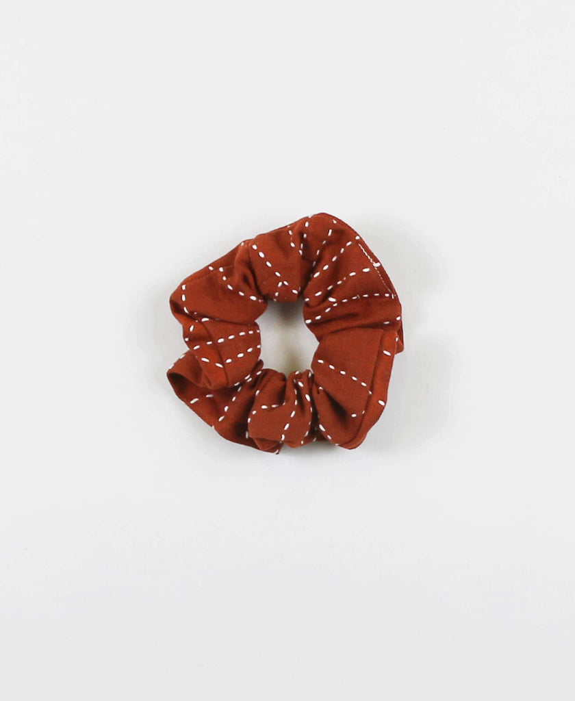 Anchal Project organic cotton hair scrunchie in rust