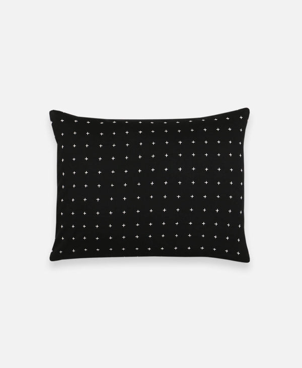 small black cross-stitch accent pillow with hand-stitched embroidery