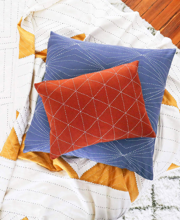 sustainably made organic cotton throw and pillows in primary colors