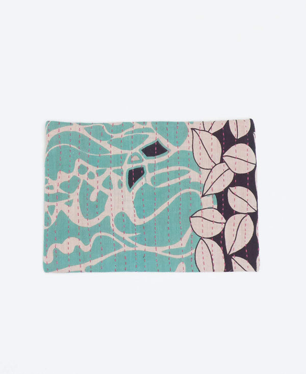 Mint and black small clutch with white and black geometric shapes made from recycled sarees and pink Kantha stitching