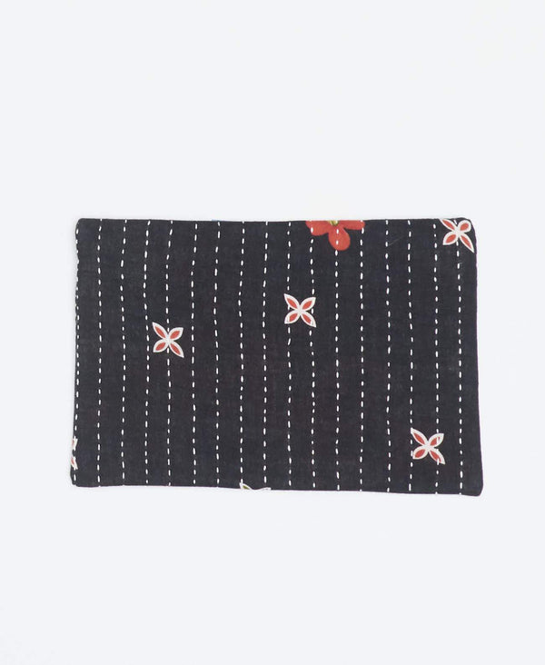 Eco-friendly black small clutch with small peach floral patterns made from recycled cotton and white Kantha stitching