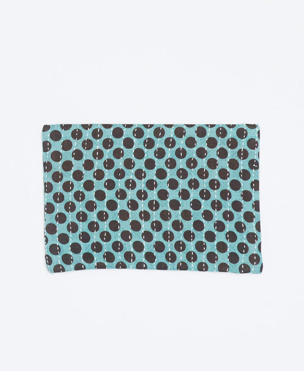 Eco-friendly teal small clutch with black polka dot patterns made from recycled cotton and white Kantha stitching