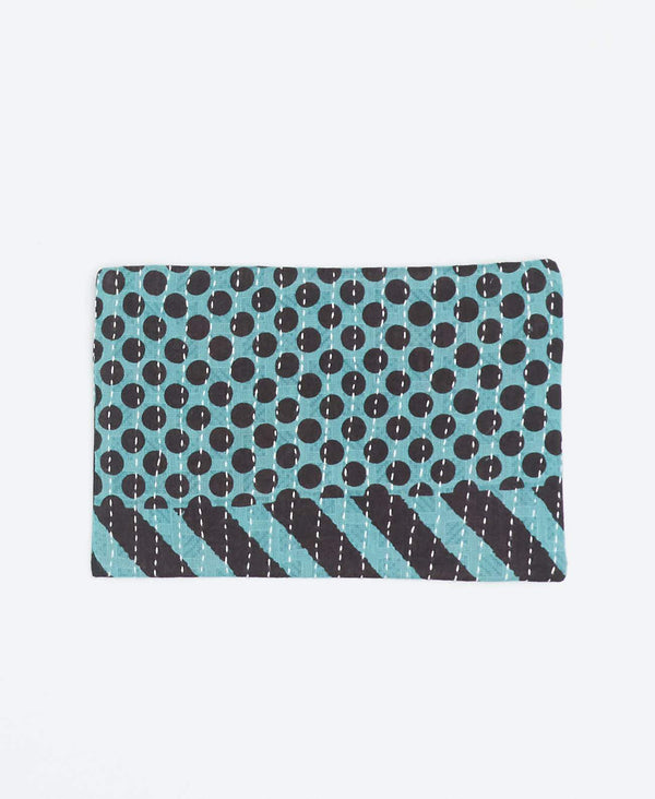 Sustainable teal small clutch with black polka dot and zig-zag patterns made from recycled cotton and white Kantha stitching