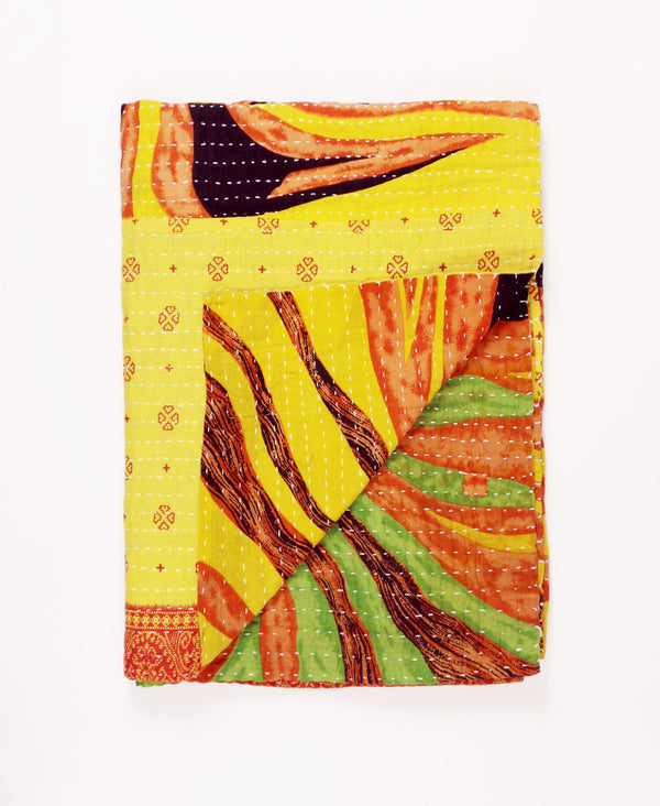 yellow kantha quilt sustainably made from layers of repurposed vintage cotton fabric