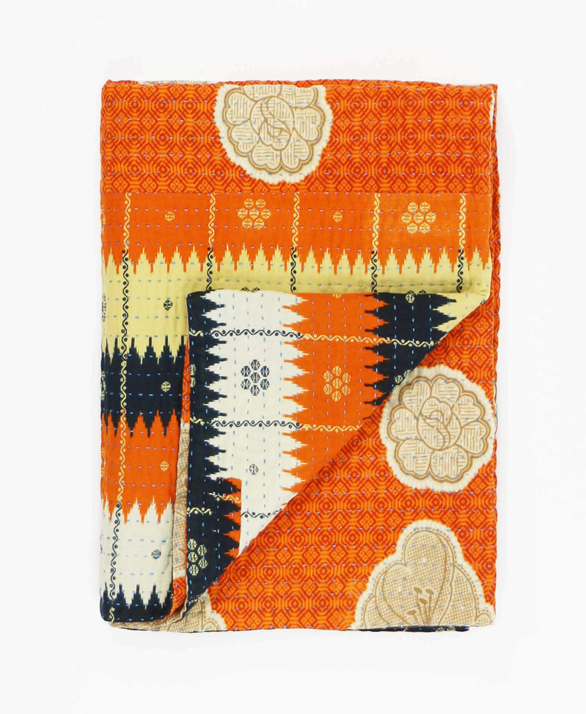 orange and navy southwestern print quilt