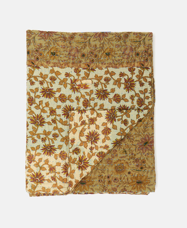 tan floral quilt with kantha stitching