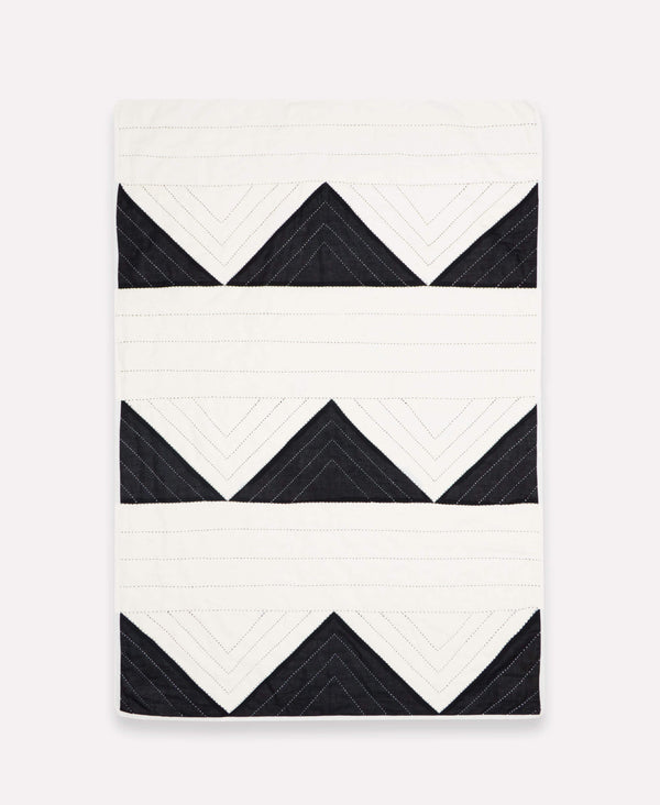 small organic cotton throw for nursery with black and white triangles