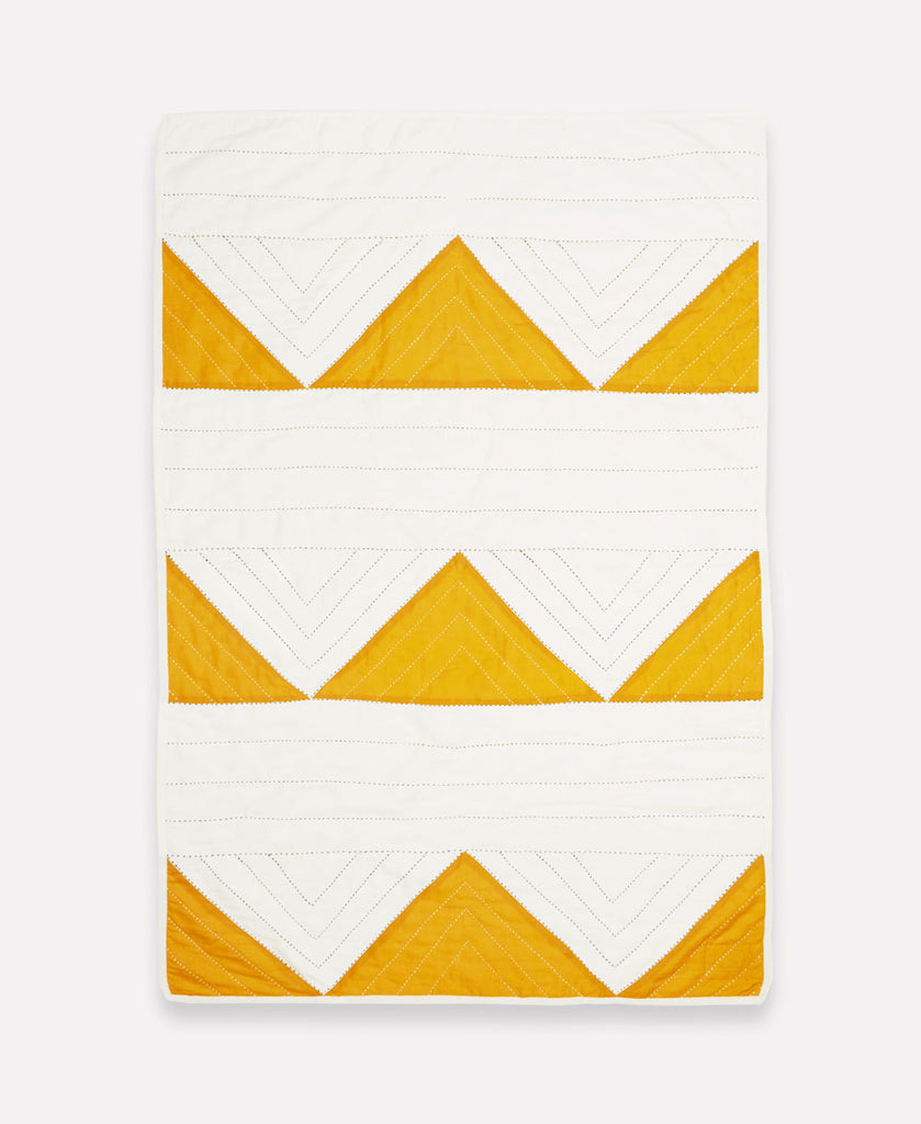 hand quilted organic cotton baby blanket with mustard yellow triangles