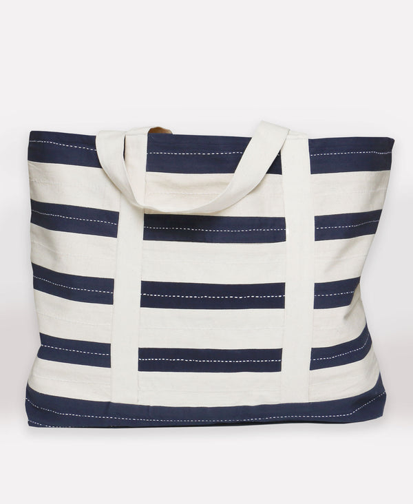 Striped tote bag hand crafted by artisans in Ajmer, India out of organic cotton