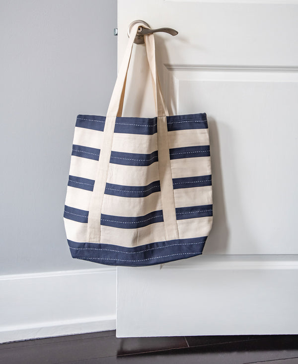 Blue and white striped large tote bag styled for a classic look