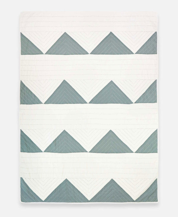 organic cotton hand-stitched quilt with geometric triangle design