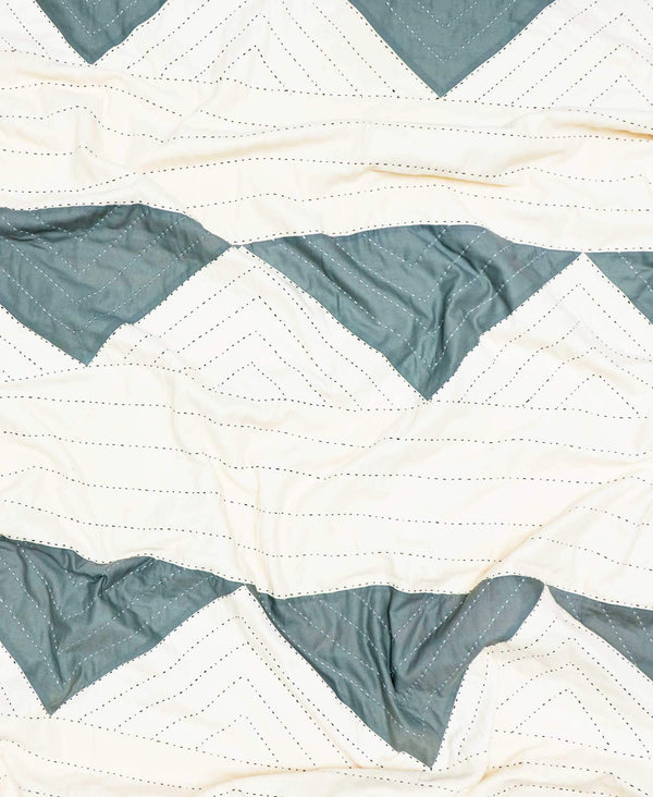 soft organic cotton quilt with geometric triangle pattern in spruce green and white