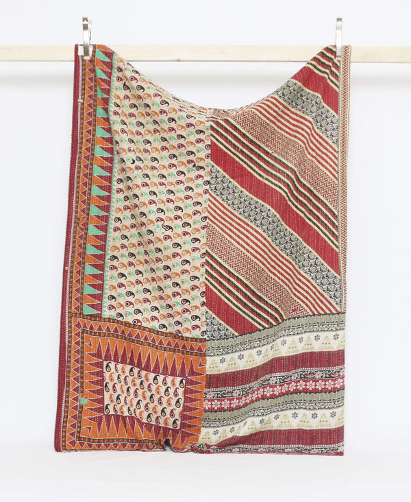Red and tan sustainble kantha twin quilt with paisley and striped patterning