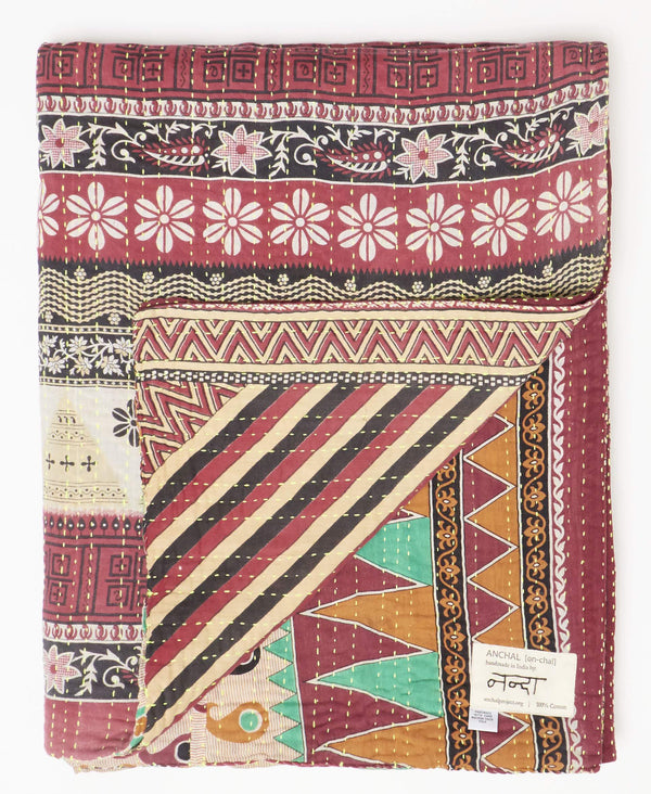 Anchal twin kantha quilt made from vintage red and tan sarees with a yellow kantha stitch