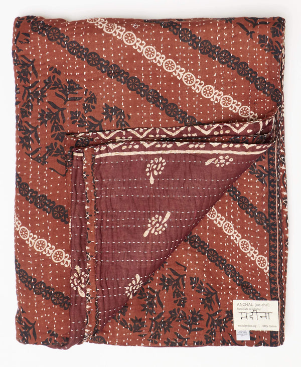 Sustainable Kantha twin quilt made from brown vintage sarees with black and white floral patters