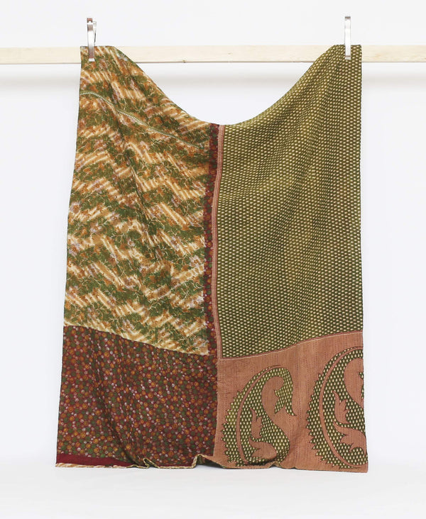 Green and red twin kantha quilt with geometric shapes and zig-zag lines and a large paisley print